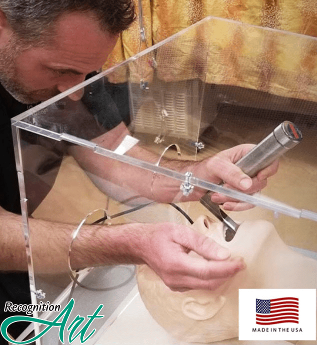 Acrylic intubation hood with hand openings to keep both the user and patient safe.